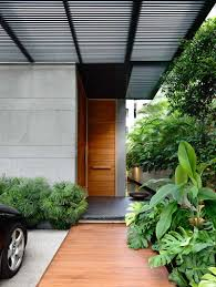 these 13 sophisticated modern wood door designs add a warm welcome