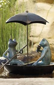 garden decor frog statue don t why i like this so much but