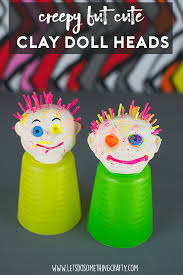 paint splatted creepy but cute air drying clay doll heads