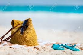 flip flop towel straw bag sun glasses towel and flip flops on a tropical
