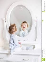 Girls White Bedroom Dresser With Mirror Baby With Curly Hair Next Round In Mirror Stock Photo Image
