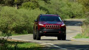 green jeep cherokee 2014 on the road 2014 jeep cherokee trailhawk