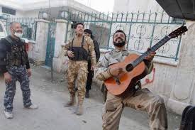 the dysfunctional guitar more on the reuters syria photo