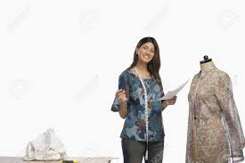 female fashion designer sketching a dress stock photo picture and