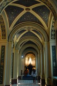 catholic pilgrimage tours detail statue arch vaulted ceiling hallway interior europe travel