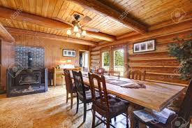 Log Cabin Home Decor Log Cabin Ruustic Living Room With Large Table And Stove Stock