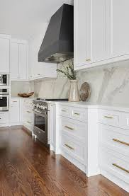 brass and black kitchen cabinet hardware black and white kitchen with brass pulls transitional
