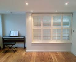 view a range of full height window shutters from shuttersouth