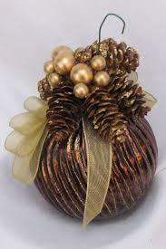 copper colored glass ornament decorated for