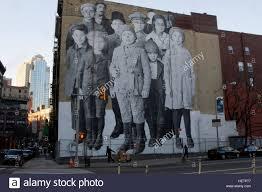 in tribeca manhattan jr a french street artist created a stock in tribeca manhattan jr a french street artist created a photographic mural depicting immigrant children at ellis island
