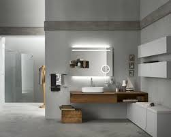 modern backlit mirror and floating wooden vanity cabinet for