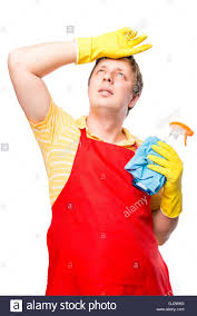 Cleaning The House by Exhausted From Cleaning The House Of A Man Housewife On A White