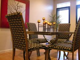 four dining room chairs in a houndstooth pattern upholstery are