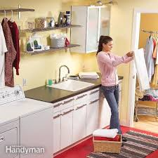 how to install base cabinets in laundry room convert an unfinished laundry area into a laundry room diy
