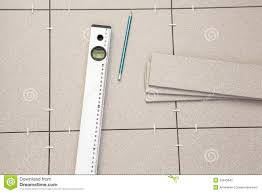 pre laying tiles on floor and level tube stock photography image