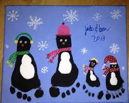 penguin footprint art for christmas super easy craft for children