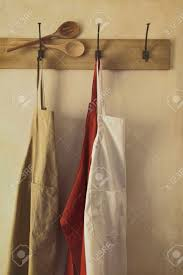 Designer Kitchen Aprons Kitchen Aprons Hanging On Hooks With Vintage Feel Stock Photo