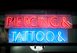 tattoo regulation and body piercing state laws and statutes afig