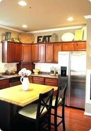 top kitchen cabinet decorating ideas decorating ideas for kitchen cabinet tops biddle me