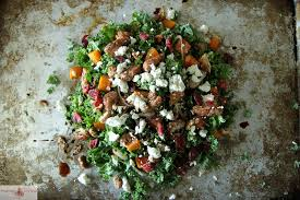 kale salad with roasted pumpkin cranberries and goat cheese