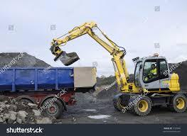 digger bulldozer filling waiting truck sand stock photo 7125946