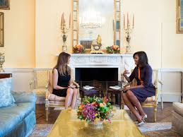melania trump and michelle obama carry on an awkward tradition