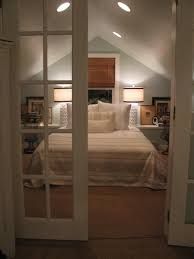 master attic bedroom french doors bamboo shades blue walls