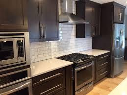 black kitchen cabinets with white subway tile backsplash shaker cabinets white subway tile backsplash quart