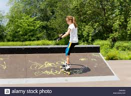 slender roller skating in the park up a