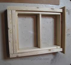 Frame A Bathroom Mirror With Molding by Create A Medicine Cabinet From A Mirror Diy Scavenger Chic