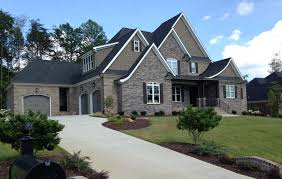 Home Exterior Design Brick And Stone Exterior Design Scheme An Overall Cool Taupe Effect Is Created On