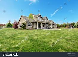 large farm country house spring green stock photo 127569056