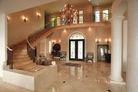 beautiful hallway and marble floors and chandelier also cove
