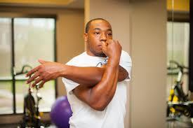 Arm Cross - shoulder cross arm stretch cass fitness