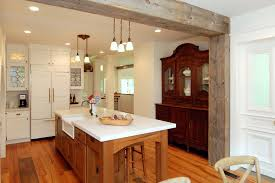 post and beam construction kitchen rustic with dining buffet