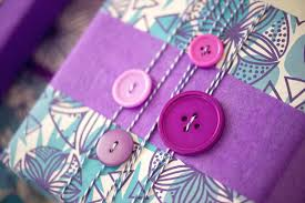 purple gift wrap gift wrapping with buttons wrappily eco friendly gift wrap