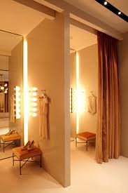 makeup lights next to the mirror dressing room of fashion retail