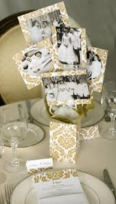 50th anniversary centerpieces something like this with photos from their wedding as