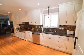 triangle shaped kitchen island granite countertop dark wood cabinets design samsung microwave