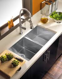 decorating oak kitchen cabinets with corian countertop and houzer