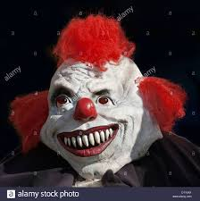 halloween background portrait portrait of face of monster clown man wearing a white mask