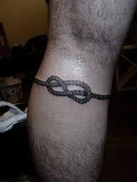 Simple Calf - simple black ink knot on leg calf ie