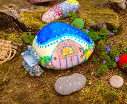 my painted rock stone fairytale cottage house for a fairy garden
