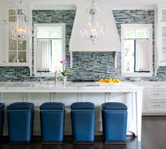 butcher block peninsula kitchen farmhouse with blue pattern tile