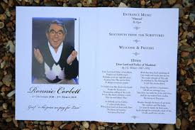 four candles lit at ronnie corbett u0027s funeral in touching tribute