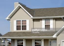residential home with vinyl siding gable roof seamless gutters