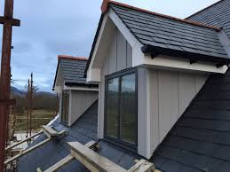 vertical cedral weatherboard used on dormer windows next to