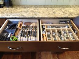 knife block and silverware dividers in the drawer storage