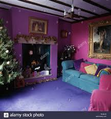 bright blue carpet and turquoise sofa in purple and pink nineties