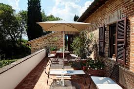 outdoor sitting area from stables to stylish 17th century italian farmhouse is now